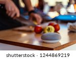smart speaker with man cutting... | Shutterstock . vector #1244869219