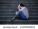 young sad and depressed asian... | Shutterstock . vector #1244900833