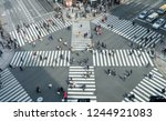 people passing the street... | Shutterstock . vector #1244921083