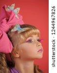 little girl blonde with long... | Shutterstock . vector #1244967826