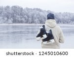 young man in white knitted... | Shutterstock . vector #1245010600