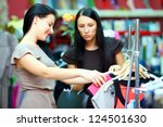 pretty women shopping in retail store - stock photo
