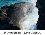 wave breaking down to splashes... | Shutterstock . vector #1245020500