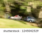 A Car Towing A Trailer Boat...