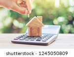 house is placed on the...   Shutterstock . vector #1245050809