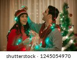 young couple wrapped fairy... | Shutterstock . vector #1245054970