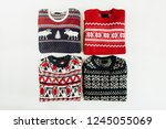 warm woolen sweaters collage on ... | Shutterstock . vector #1245055069