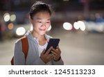 beautiful asian woman use... | Shutterstock . vector #1245113233