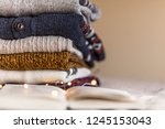 a stack of woolen sweater on... | Shutterstock . vector #1245153043