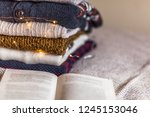 a stack of woolen sweater on... | Shutterstock . vector #1245153046
