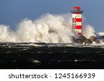 big waves crashing against the... | Shutterstock . vector #1245166939