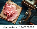 raw pork chops and meat grinder ... | Shutterstock . vector #1245233533