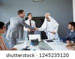 arabian partner handshake with... | Shutterstock . vector #1245235120