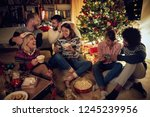happy young friends with gifts... | Shutterstock . vector #1245239956
