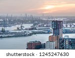 Small photo of Rotterdam, The Netherlands, November 12, 2018: aerial view of modern residential buildings at Lloydpier with the river Nieuwe Maas and harbour activities in the background