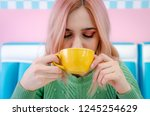 girl with pink hair drinking... | Shutterstock . vector #1245254629