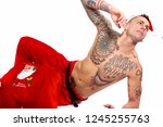 bare chested santa claus with... | Shutterstock . vector #1245255763