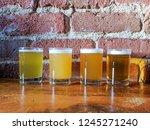 craft beer flight of four ipa's ...   Shutterstock . vector #1245271240