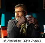bearded middle aged man... | Shutterstock . vector #1245272086