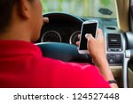 asian man sitting in car with... | Shutterstock . vector #124527448
