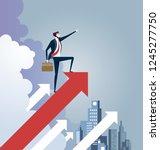 businessman standing on arrow... | Shutterstock .eps vector #1245277750