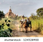 BAGAN, MYANMAR - NOVEMBER 4; Tourist are visiting the Bagan valley by pony   cart on Nov. 4 2011, Bagan, Myanmar.Bagan contains thousands of ancient pagodas and temples , all UNESCO protected - stock photo