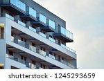 modern apartment buildings on a ... | Shutterstock . vector #1245293659