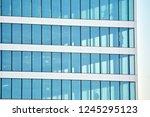 view of modern glass skyscraper ... | Shutterstock . vector #1245295123