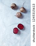 raw beetroot on gray stone... | Shutterstock . vector #1245315613
