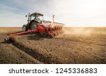 farmer with tractor seeding ... | Shutterstock . vector #1245336883