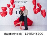 red balloon heart covering... | Shutterstock . vector #1245346300