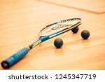 close up of a squash racket and ... | Shutterstock . vector #1245347719