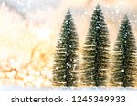christmas tree on snow with... | Shutterstock . vector #1245349933