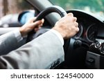 close up of hands on a steering ... | Shutterstock . vector #124540000