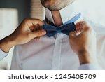 grooms morning preparation... | Shutterstock . vector #1245408709