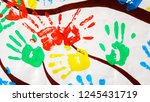 the stamp of many hands painted ... | Shutterstock . vector #1245431719