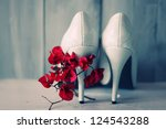 Photo Of White Shoes And Flowers