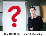 brunette woman standing next to ... | Shutterstock . vector #1245467266