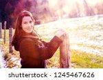 portrait of brunette young... | Shutterstock . vector #1245467626