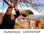 brunette young woman standing... | Shutterstock . vector #1245467629