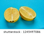 lemon in section on blue... | Shutterstock . vector #1245497086