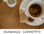 fresh coffee on wooden table | Shutterstock . vector #1245507973