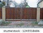 Closed Brown Wooden Doors On...