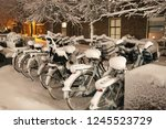 7 Snow Covered Bicycles Are...