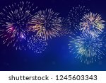 brightly colorful fireworks... | Shutterstock .eps vector #1245603343