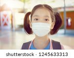 little girl in school uniform... | Shutterstock . vector #1245633313