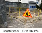 road repair sign and yellow... | Shutterstock . vector #1245702193