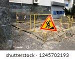 road repair sign and yellow... | Shutterstock . vector #1245702193