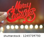 "hand holding words ""merry... 