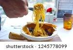 pasta spicy seafood | Shutterstock . vector #1245778099
